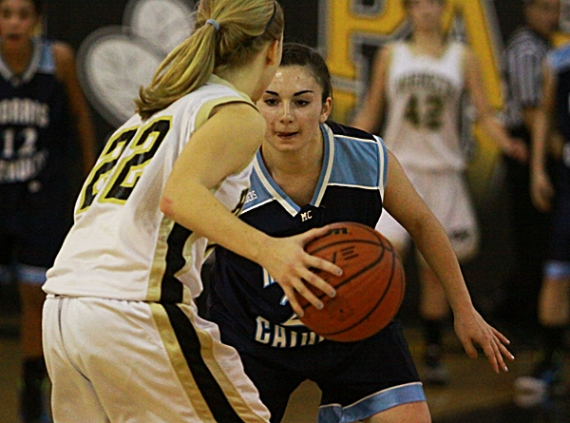 Hanover Park's Kate Bodnar is guarded closely by Devin D'Amico of Morris Catholic.