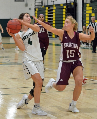 Bella Vito of Montville takes the ball to the hoop while being guarded by Morristown's Tara O'Neill in Morris County Tournament quarterfinal action.