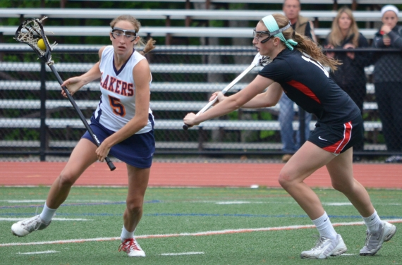 Mountain Lakes' Rachel Treweeke works her way around a Glen Ridge defender.