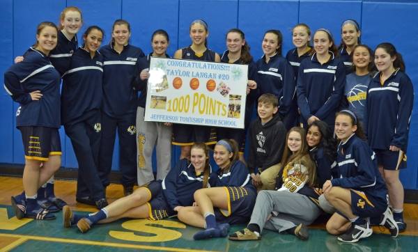 Jefferson's Taylor Langan poses with her teammates after scoring her 1,000th career point.
