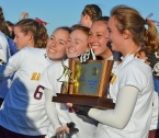 Madison players display the trophy they won for capturing the Group II title.