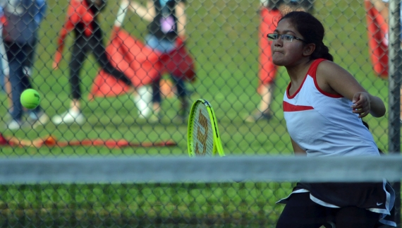 Kaveesha Kodituwakku, a three-year starter for the Bombers, gets ready to return a forehand.