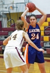 Mountain Lakes senior forward Krysta Rigby looks to pass while being guarded by Madison's Courtney Bland.