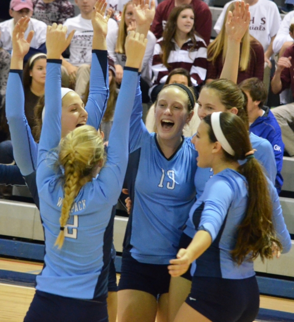 West Morris volleyball players celebrate their win over Morristown in the MCT semifinals.