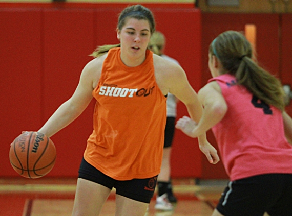 Brianna Zazzaro attempts to dribble past teammate Sarah Fasino during practice on Monday afternoon.