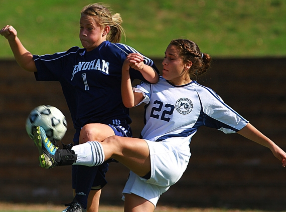Mendham's Paige Russell and Randolph's Dana Shalit battle for the ball.