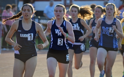 Randolph's Brooke Olson is in the lead midway through the 3,200 at the Morris County Track and Field Championships.