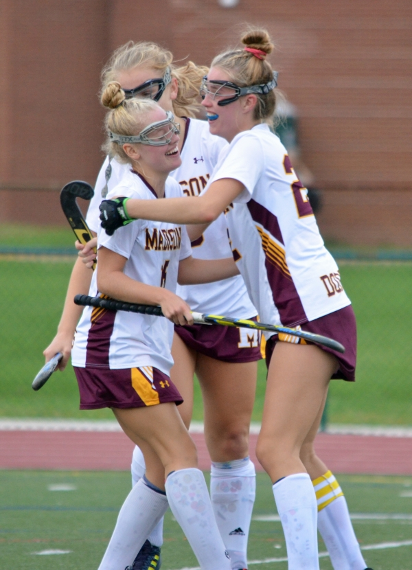 Chase Cmaylo, left, is congratulated by Sarah Cox and other teammates after scoring Madison's first goal versus Warren Hills on Sept. 21, 2018.