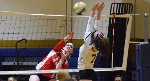 Mendham's Michaela Sharp sends the ball over the net. Madison's Alise Bassolino goes up for the block.