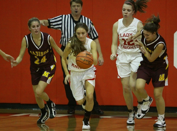 Morris Hills ' Gina Aragona brings the ball up the court in Thursday night's game against Madison.