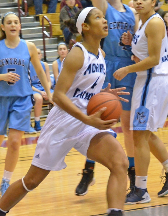 Morris Catholic's Stella Johnson, above, drives to the basket.