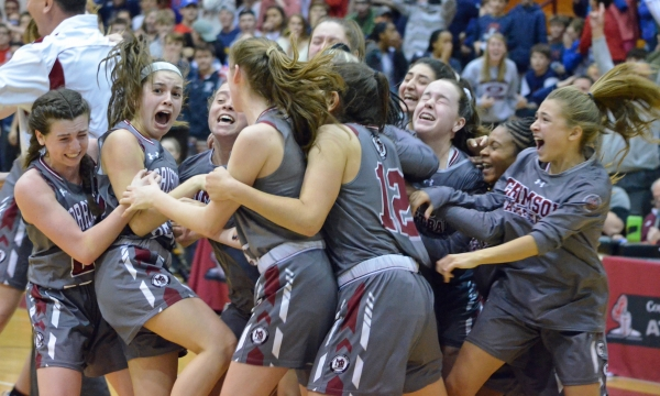 Christina DeMattheis, second from left, and her teammates revel in her buzzer-beating shot in the 2019 Morris County Girls Basketball Tournament final.