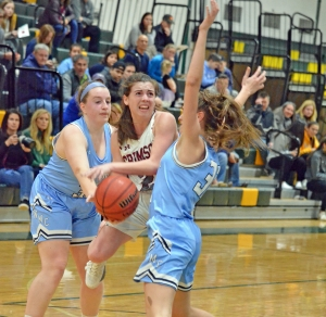 A pair of West Morris defenders apply pressure to Morristown-Beard's Bridget Monaghan in a MCT quarterfinal on Saturday, Feb. 9, 2019.