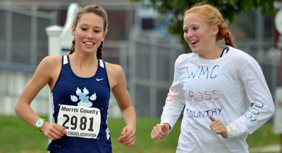 Sierra Castaneda, left, goes on a cooldown run with friend and teammate Erin Hughes.