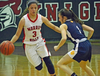 Morris Hills point guard Maddison Perna, left, tries to get past St. Elizabeth's Bella Ferriso.