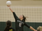 Kinnelon's Erin Higgins goes above the net and dinks the ball.