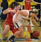 Hanover Park's Emily Seynour, right, chases down a loose ball.