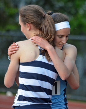 Abby Loveys of Randolph and Julia Trethaway of West Morris embrace after a tight race in the 3,200 meters at the Morris County Track Championships.