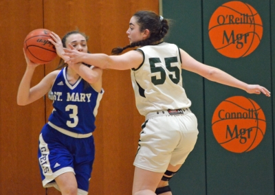 Villa Walsh's Caroline Dolan, a senior center, attempts to prevent a St. Mary player from passing.