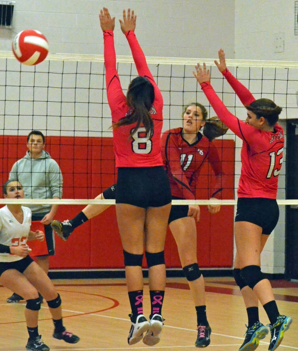 Mount Olive's Annie Karle sends a crosscourt kill over the net during a match versus Jefferson.
