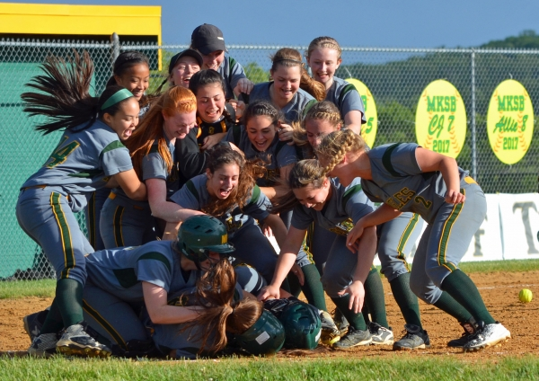 Morris Knolls players celebrate their extra-innings win over Bloomfield in a North Jersey Section 1, Group IV semifinal on Friday, May 26, 2017.