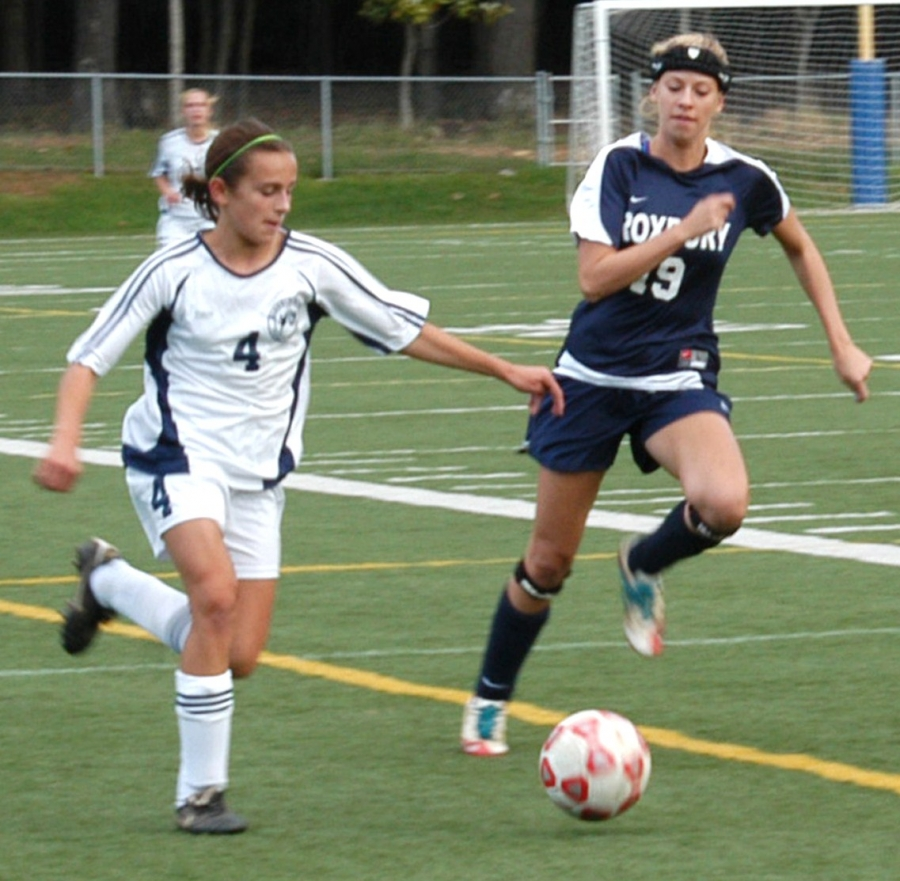 Randolph's Maria Fairfield, left, and Roxbury's Madison Temples in action.