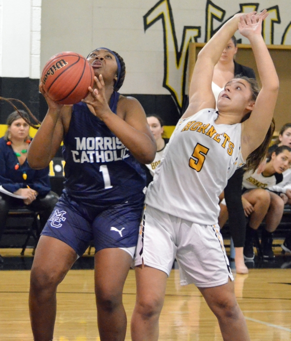Morris Catholic's Tyonna Bailey, left, goes up for a shot as Alyssa Alfano of Hanover Park defends.