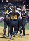 The Hornets rush to pitcher Jessica Miller after she made the final out of the MCT final.