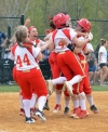 The Marauders celebrate Annalee Smith's game-winning hit. Mount Olive edged Randolph, 3-2, in eight innings in a MCT semifinal on May 5, 2018.