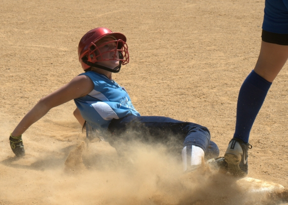 Kirsten Taylor of PTW slides into third base.