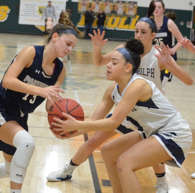 St. Elizabeth's Quinn Galligan, left, and Angeleen Mulero of Randolph battle for a loose ball during an MCT quarterfinal on Saturday, Feb. 15.