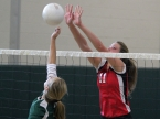 Mount Olive's No. 11, Ally Karle, blocks a shot hit by Montville's Nicole Dvoretsky.