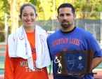 First singles player Emily Krupnick and Mountain Lakes coach Rob Elia pose with the sectional championship trophy.