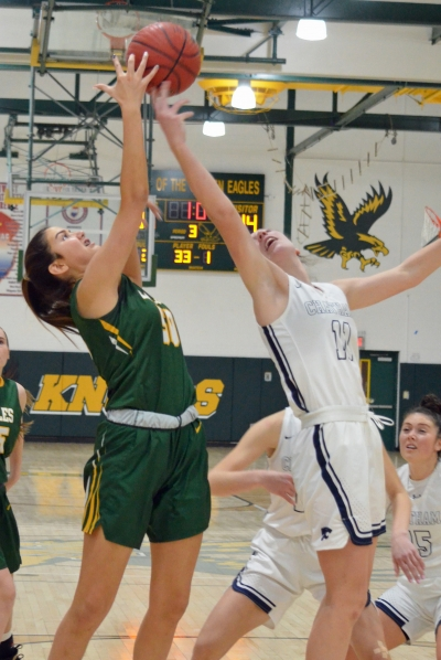 Morris Knolls' Maddy Knaack, left, and Chatham's Carly Frohnapfel vie for a rebound in a Morris County Tournament quarterfinal on Saturday, Feb. 15, 2020.