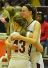 Morristown's Kayla Bush, right, hugs teammate Elizabeth Strambi late in the fourth quarter of a Group IV semifinal versus Franklin.