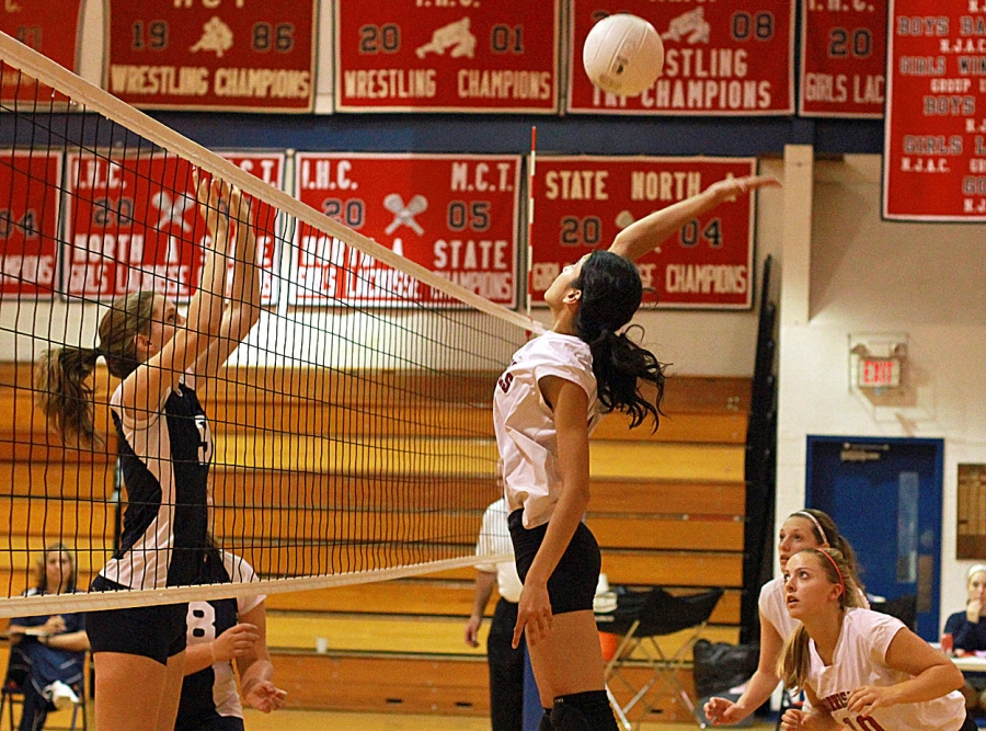 Mendham's Morgan Potucek, left, goes up for a block against Morris Hills' Shefali Jain.