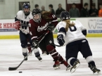 Mikhaela Schultz of Morristown-Beard brings the puck up the ice against Wyoming Seminary.