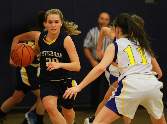 Jefferson's Claudia Tietz brings the ball upcourt as Ally Herring of Spotswood defends.