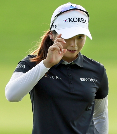 Hye-Jin Choi reacts after making a birdie putt on the 16th hole to gain a share of the lead during the third round of the 2017 U.S. Women's Open.