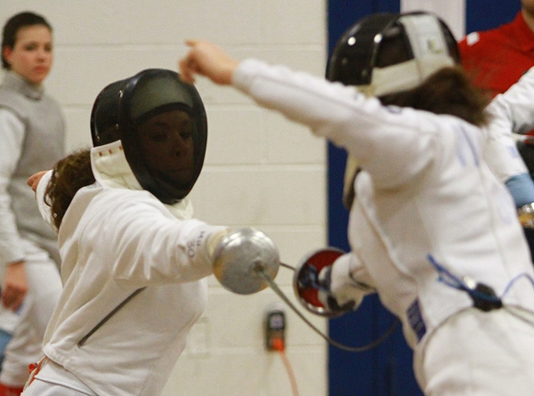 Sam Agront of Morris Hills, left, went up against Kaitlyn Wallace in an epee bout.