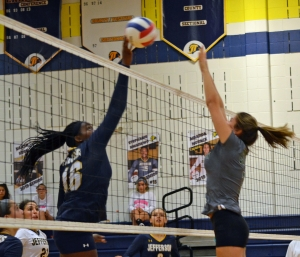 Amanda Nwankwo of Jefferson, left, goes up for a kill in a match versus Kinnelon.