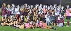 The Morristown field hockey team celebrates Diane DeSalvo's 400th win by wearing masks bearing their coach's face.