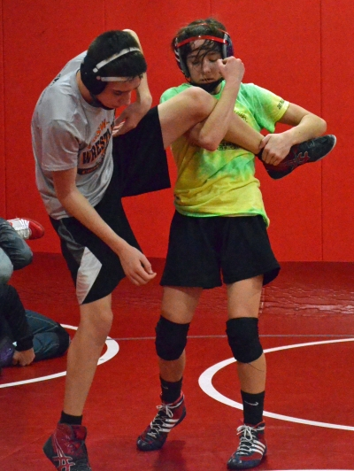 Parsippany's Sydney Petzinger, right, practices single takedowns with Anas Sawalhi at a workout on Friday, Feb. 15.
