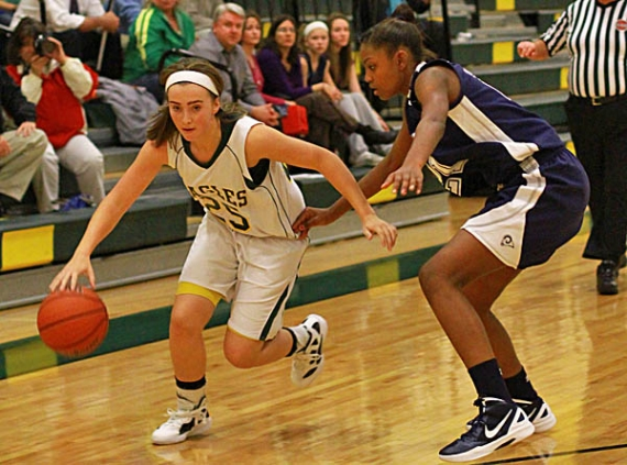 Tori Clarke of Morris Knolls drives the baseline against Aliyah Huland El of Randolph.