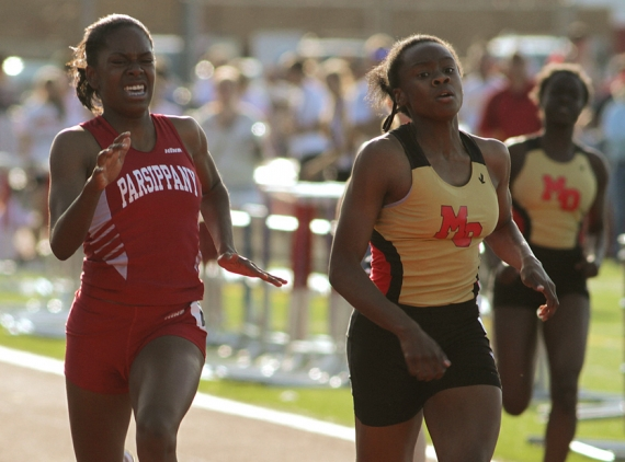 Parsippany's Bria Saunders and Mount Olive's Keturah Orji finish one-two in the 200-meter dash.