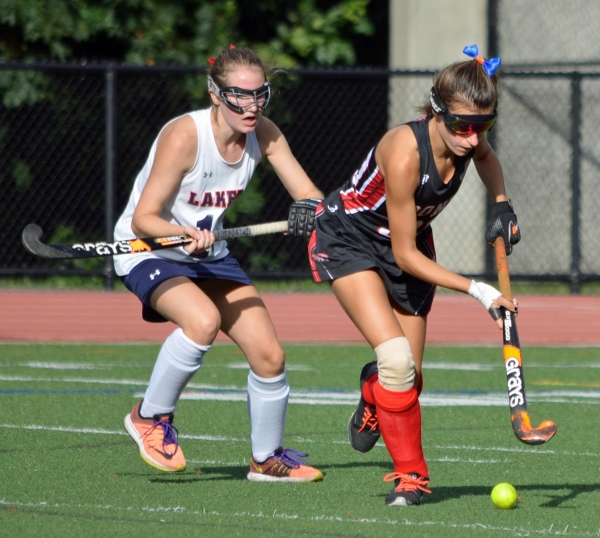 Boonton's Nicole Kroszer, right, controls the ball while being pursued by a Mountain Lakes defender. Kroszer had two goals versus the Lakers.