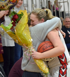 Devin Gibbs, right, hugs her best friend, Vanessa Lomakin, after scoring her 1,000th point on Wednesday, Jan. 23, 2019.
