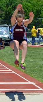 A Morristown triple jumper is airborne during the trials.