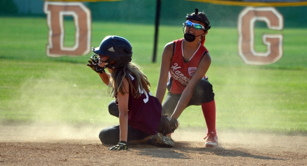Hanover shortstop Brynn Yacat applies the tag at second base in the second game of the Section 1 Little League Softball Tournament.